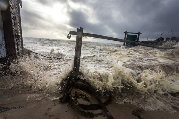 Winter storms surge across the slipway at The Kom, causing damage to infrastructure. Photo: Mark Harley