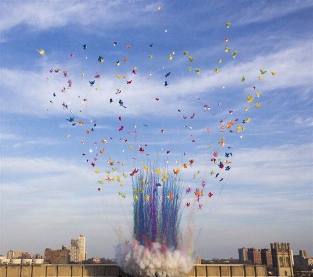 """Cai Guo-Qiang's """"Mushroom Clouds"""" above the Regenstein Library at the University of Chicago. Image courtesy of Fireworks."""