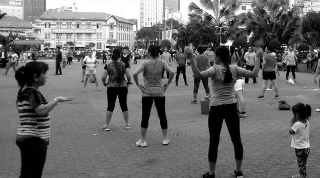 The citizens of Ho Chi Minh City hold free exercise classes in the new public park near Ben Thrah Market. Photo credit: Patrick McInerney